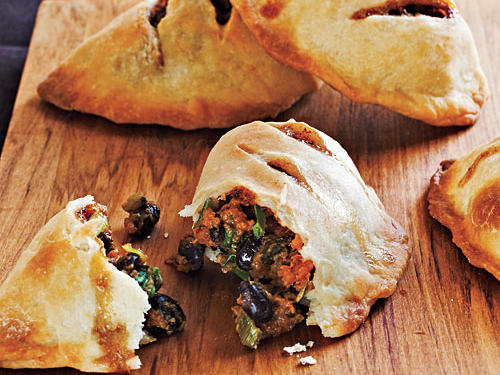 Mild sweet potatoes and black beans take on smoky, spicy tastes from cumin and chiles. These pies are great served hot out of the oven at a party; leftovers also make a tasty room-temperature snack.