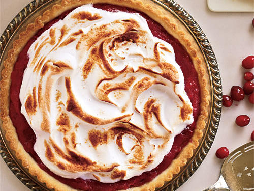 A flaky homemade crust surrounds a smooth, luscious curd made of fresh cranberries and topped with meringue.