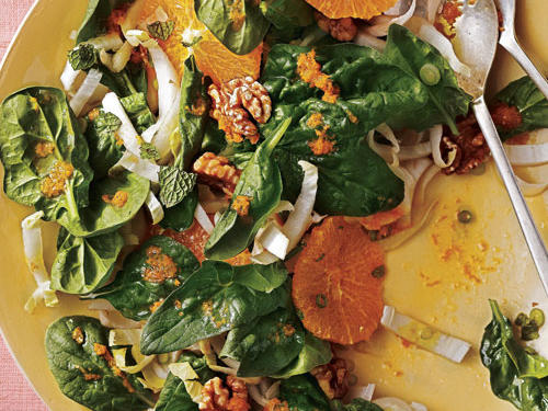 Our spinach salad hits a lot of flavorful notes; sweet fruit, earth nuts, refreshing mint, and a slight bitterness from Belgian endive mix together for a delectable combination.