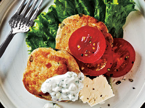 Pair Greek chicken patties with a creamy Tzatziki-style sauce and serve with sliced tomatoes, lettuce leaves, and sliced feta cheese for a quick weeknight-friendly meal.