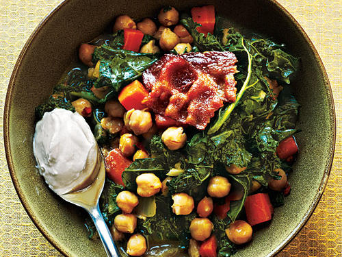 Kale comes together with ingredients you probably already have on hand—bacon, canned chickpeas, onion, carrot, Greek yogurt—for a budget-friendly dish full of smoky, earthy flavor. Serve with torn baguette bread to soak up all the tasty juices.