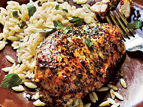 Chicken receives a flavor kick with a medley of herbs in this satisfying dish. Orzo dressed with parsley makes for a refreshing accompaniment.