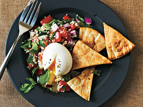 This Middle Eastern-inspired breakfast is a popular selection at Café Medina in Vancouver, where the dish includes a boiled egg and three salads—tabbouleh, cucumber salad, and baba ghanoush—complemented with crisp pita toasts. Our simplified version features just one salad—tabbouleh.