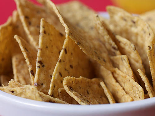 With ingredients like protein-packed quinoa, fiber-rich corn bran and brown rice, and omega-3-providing flax, it's hard to deny that Laurel Hill Multigrain Tortilla Chips are one of the healthiest chips around. Their sturdy and crispy texture made them an immediate staff favorite. The curved shape of the chip makes it perfect for dipping in your favorite salsa or guacamole but they definitely hold their own as a stand-alone snack. If you like the Multigrain, give the Sea Salt & Lime flavor a try.Serving size: 1oz/8 chips, 140 cals, 6g fat (0.5g sat fat), 0mg chol, 80mg sodium, 3g fiber, 2g protein