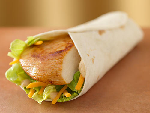 While their menu sports a lot of grilled items, Wendy's Grilled Chicken Go Wrap is one of the few that's not as high in sodium. Calories are a mere 260 with 10 grams of fat (3.5 g sat) and 630mg sodium. Add a garden side salad with Fat Free French Dressing (60 calories, 125mg sodium) and apple slices (40 calories, 0 sodium). Stay away from the competitors' chicken wraps that sport fried chicken and fatty dressings.
