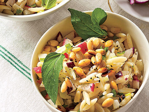 Lemony dressing and fresh mint add vibrant flavor to this pasta salad. Pack some mint leaves in your picnic basket to garnish it, if desired.
