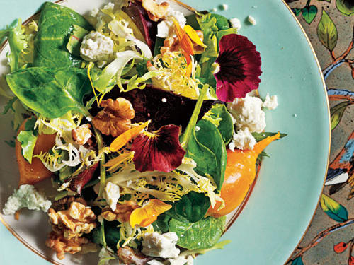 This salad if full of color and flavor, as well as being packed with nutrients. Sharp, creamy goat cheese rounds out the bitter greens and sweet beets.