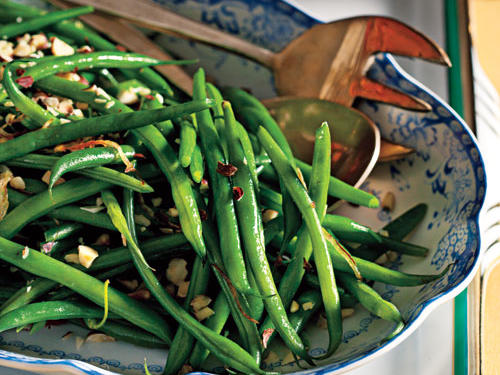 Sautéed shallots and toasted hazelnuts give this fresh green bean dish a burst of flavor.