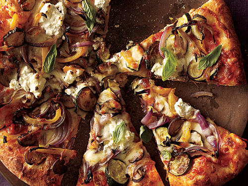 To lower fat and calories in pizza by around half, swap mozzarella for part-skim ricotta. Make it an opportunity for vitamins and minerals by loading up on the veggies.