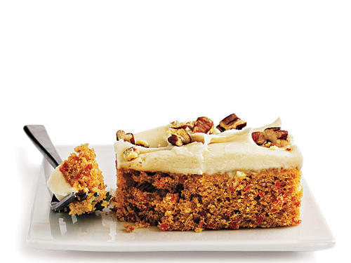 This lighter twist on traditional carrot cake features a tender cake packed with grated carrot, juicy pineapple, flaked coconut, and chopped pecans. Cream cheese frosting and a garnish of grated carrot tops the cake.View Recipe: Carrot Cake