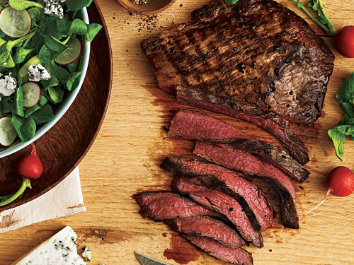 Perfectly seasoned flank steak placed atop a bed of leafy greens makes a divine spring-inspired meal. If you can't find mâche, use butter lettuce.