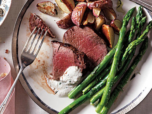 Beef tenderloin looks sophisticated but is an easy dinner party main dish. The lean beef pairs well with a coating of black pepper and a side of zesty horseradish and chive sauce.
