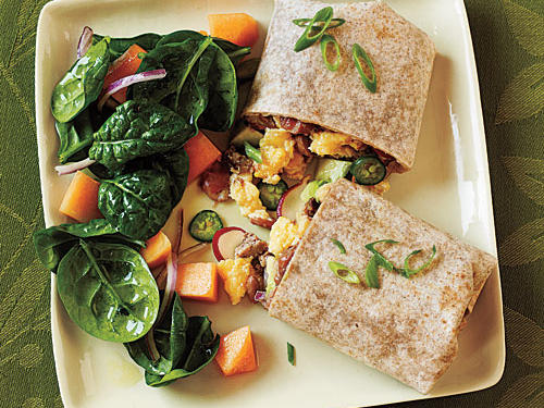 Avocado and sausage elevate this basic egg burrito to satisfying lunch fare. Serve with a salad of fresh spinach, sliced red onion, and cubed cantaloupe.