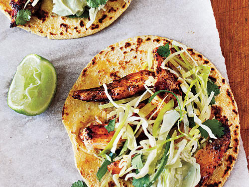 Crunchy cilantro slaw and cool, fresh avocado cream are all the dressing these chicken tacos will need.