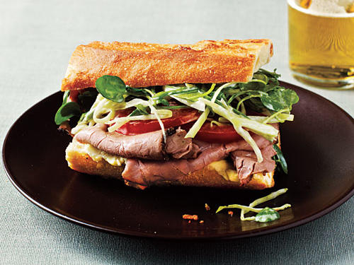 Watercress slaw gives the perfect amount of crunch in this roast beef sandwich. A crusty baguette is a must—satisfaction from the very first bite.