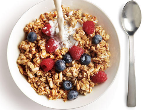 Whole-grain cereal and low-fat milk is the ideal way to start your day on all cylinders or to refuel after a workout. Not only does it serve up an energizing mix of protein, fiber, and slowly-digested complex carbs, it's ready in less than a minute. For even more muscle, choose a cereal that's been fortified with iron, a mineral we need to form hemoglobin, which delivers oxygen throughout our bodies. And don't forget to add in some sliced strawberries. Their vitamin C will help you absorb even more of your cereal's iron.