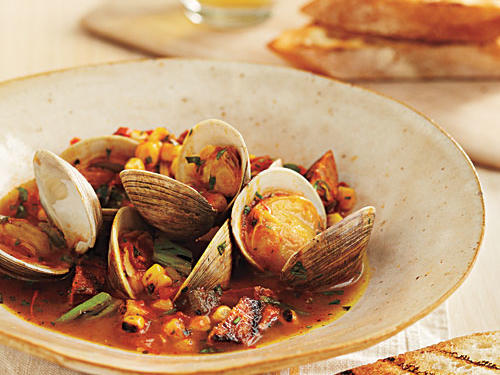 Spanish flavors inspire this simple but intense summery braise. Saffron gives the tomato broth a nutty complexity, while the spice and heat of chorizo liven up the clams.