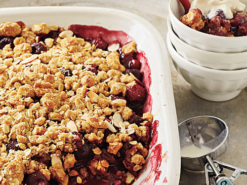 Fresh tart cherries can be hard to find, which is why we add some dried ones to boost the flavor of this crisp. If you have access to fresh tart cherries, use 3 pounds and omit the dried fruit. Serve with vanilla low-fat ice cream, if desired; a small (1/4-cup) scoop will add 55 calories and 0.5 grams of saturated fat to each serving.