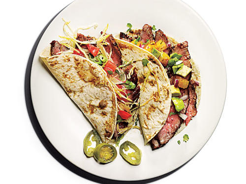 Flank steak gets some south-of-the-border flair when it's grilled and combined with paprika, cumin, and vegetables, then wrapped up in a corn tortilla. For a winning combination, serve with a side of pico de gallo and chips.