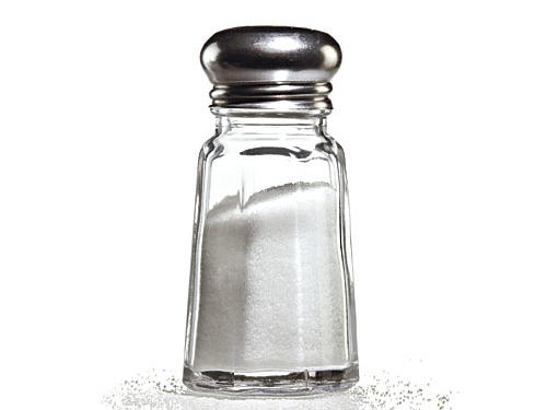 Fill your salt shaker with pepper and your pepper shaker with salt. Since salt shakers have more holes, the switcheroo will help to slash your sodium intake.