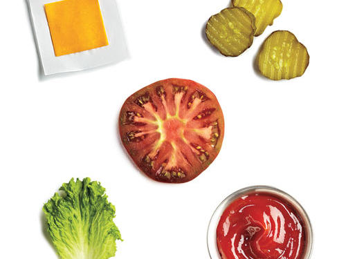 2 teaspoons ketchup + 3 dill pickle chips + 1 thin slice sharp cheddar + green leaf lettuce + 1 heirloom tomato slice