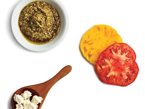 1 tablespoon pesto + 2 heirloom tomato slices + 1 tablespoon crumbled feta