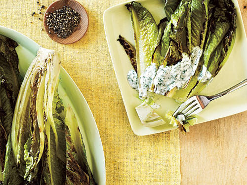 A brief turn over hot coals wilts hearty romaine lettuce ever so slightly and infuses it with a delicious smoky flavor, yielding a special salad that's easy to put together. Serve with any type of grilled meat, fish, or burgers.