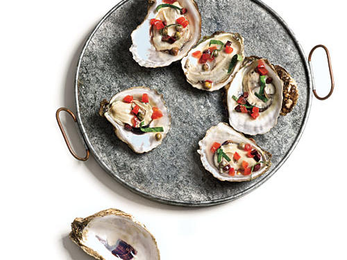 If your experience with smoked oysters is limited to the oily, strong-flavored bivalves sold canned, you're in for a revelation. The brininess of the olive- and caper-laced relish echoes the fresh, oceany notes of the oysters. Keep as much of the oysters' juices as possible in the shells while shucking and grilling.