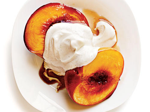 If you have the willpower, keep this recipe in the files until July and August roll around and peaches are at their most delicious. Then, as the fruit hangs on the trees soaking up sunshine during summer's hottest days, all the magic happens. Crisp flesh softens, and sugar levels rise to balance the tart acidity. No question: Peak peach time is worth the wait. Creamy yogurt is brought to another level when scooped over these peaches.