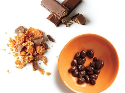 1 tablespoon crushed Butterfinger + plus 1 tablespoon crumbled Kit Kat + 1 tablespoon chocolate-covered raisins; 155 calories