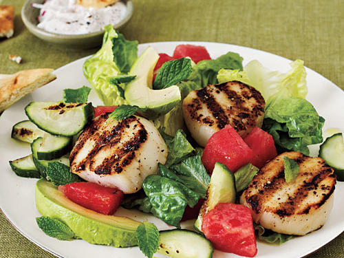Grill scallops and cucumber halves for tasty toppings on this fresh and flavorful salad. You'll love how the sweet watermelon and mint flavors play off one another. *To make paleo-friendly, remove cooking spray.