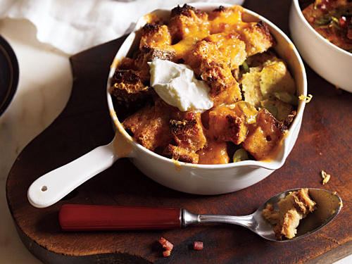 Comforting bread pudding becomes a breakfast dish by using savory rather than sweet ingredients. Preparing it in individual ramekins gives it a dressier feel and shortens cooking time.
