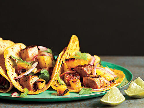 How can you make pork and pineapple an even better dinner duo? Tuck the two into warm corn tortillas for a zesty take on taco night. Fresh, juicy pineapple adds a cool, refreshing balance to spicy chipotle, ancho chile powder, and jalapeño peppers; if the spice level is a bit much, simply seed the jalapeño to tame the heat down a notch or two. The pork and salsa combination is quite juicy, so look for a thicker, sturdier corn tortilla like those from La Tortilla Factory to keep all those flavors from escaping.