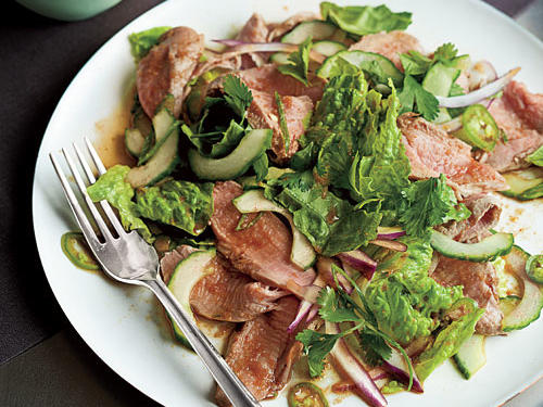 Serving pork on a bed of light and fresh salad will make for a divine presentation. Slicing speeds up the cook time substantially in this recipe. But if you're not in a rush, let the juice–fish sauce mixture stand for 20 to 30 minutes before mixing with the pork. The mixture is a twist on nuoc cham, a traditional Vietnamese dipping sauce and condiment that features the classic Vietnamese flavor balance of salty, sweet, sour, and savory. When the mixture stands for about a half an hour, the flavors meld and grow into a complex sauce that's far more delicious than the sum of its parts. Fresh mint and cilantro add wonderfully bright notes to this salad.