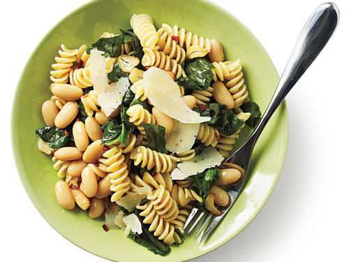 With earthy beans, bitter greens, and sharp Parmesan cheese, this light pasta doesn't sacrifice flavor. Serve with fresh fruit for dessert for a well-balanced meal.