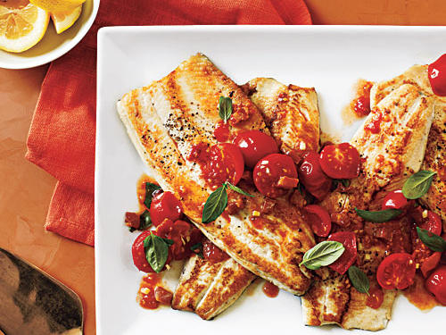 A tomato sauce moistens the fish, making this company-worthy recipe foolproof.
