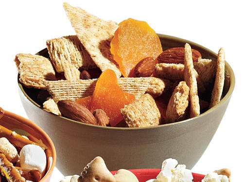 1 1/2 cups Post Honey Nut shredded wheat, 1 cup dried mangoes, 3 cups Triscuit whole-wheat thin crisps, 1/2 cup roasted almonds1/2 cup mix = 125 calories, 2.2g fiber