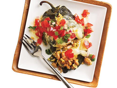 Poblano peppers are stuffed with a delicious combination of pinto beans, bulgur, and fresh Mexican flavors for a delicious meal.