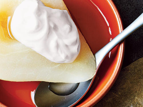 With minimal effort, you can have a delicious and festive fall dessert on the table that is dressed to impress with a dollop of creamy yogurt. Spoon a bit of the cooking liquid over the pear for a tasty finishing touch.