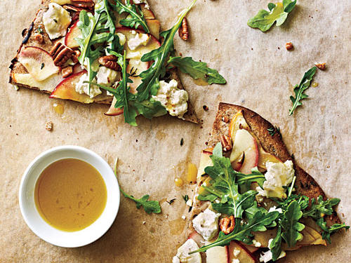 Take a walk on the culinary wild side with this adventurous pizza. Thinly sliced Fuji apples, goat cheese, toasted pecans, baby arugula, and fresh thyme meld together in a tantalizing blend of flavors for a unique dinner pizza.