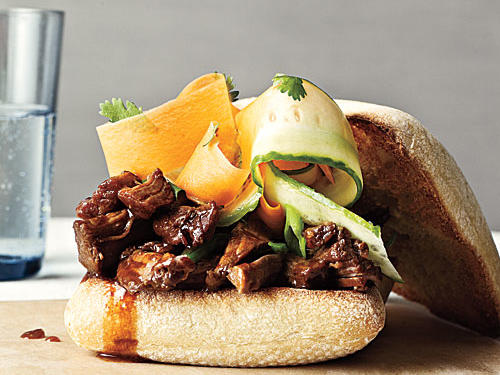 Serve this East-meets-West pulled pork on hamburger buns or Kaiser rolls with shaved cucumber and carrot ribbons tossed with rice vinegar. Or stuff it into tortillas for Asian-style tacos with matchstick-cut cucumber and carrot.