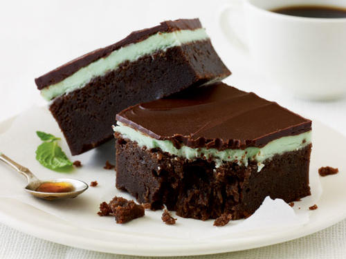 You'll love these if you're a big fan of the Girl Scouts' Thin Mint cookies. The dense base layer is like a rich, fudgy brownie, so don't overcook it or the dessert bars will be dry. Refrigerating the mint bars allows the chocolaty top layer to set properly. You can make the dessert up to one day ahead.