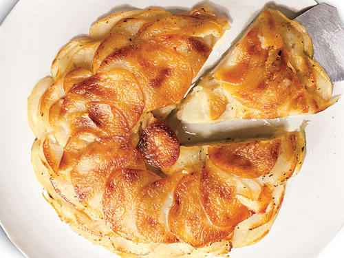 Put out white truffle-scented pommes Anna and sit back for the oohs and aahs. A small amount of truffle oil infuses the whole dish with loads of earthy essence. If you don't have truffle oil, you can use olive oil for a more subtle flavor.