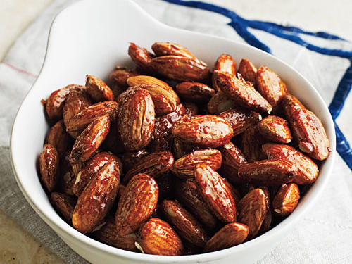 Spiced nuts are usually baked; this stovetop version speeds up the process. The smoky-spicy snack will store well in an airtight container for several days.