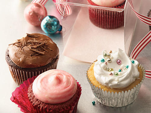 Clear plastic box (containing cupcakes) available at clearenvelopes.com ($10.80 for a package of 10).Silver foil baking cups available at wilton.com ($1.99 for package of 24).Red glassine muffin cups from fancyflours.com ($4.85 for package of 45).Striped ribbon 3/8-inch wide acetate ribbon from Tinsel Trading ($1.40 per yard).