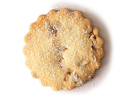 Dust cookies with a bit of powdered sugar for a finishing touch that's not too sweet. Place sugar in a fine sieve, and shake it over cooled cookies.