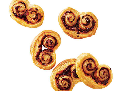 You can either thaw the puff pastry in the fridge overnight or leave it out at room temperature for 1 to 2 hours until it's pliable. These palmiers look a bit more complicated than the tarts, but don't be alarmed. Just roll each side in a jelly-roll fashion until they meet in the middle. Be sure to chill dough for 20 minutes before cutting.