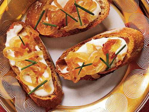 Serve with Basic Crostini, or melba toast. For an upscale version, thinly slice onions, and caramelize as directed. Then combine cream cheese, mayo, pepper, and salt; spread over crostini, and top with onions and chives.