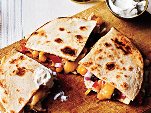 So quick and easy to make, these spicy quesadillas will become a dinnertime go-to meal in no time. To make the dish kid-friendly, simply omit the pickled jalapeño peppers.