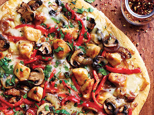 Cubed chicken breast halves along with sweet Italian sausage, mushrooms, and plenty of veggies make for a tasty pizza sans red sauce. Ask for fresh pizza dough in the bakery of your supermarket to yield a crust with pizzeria quality.